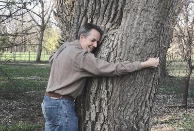 Man hugging large tree